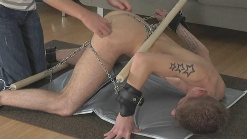 Tattooed pale gay acquires every part of his body handcuffed