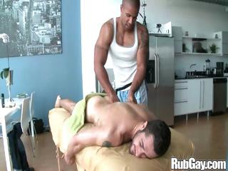 Tired homosexual rugby player acquires a admirable relaxing massage on his back and booty from a masseur stud
