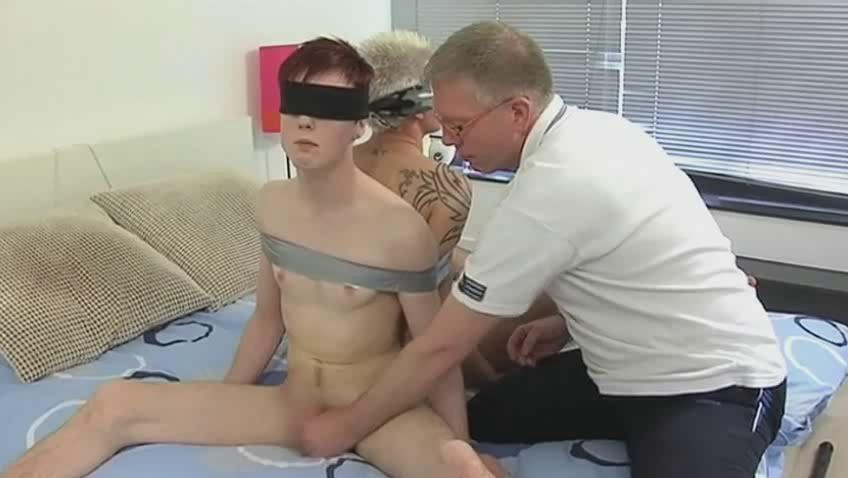 Aged gay daddy ties 2 randy twinks and engulf their cocks