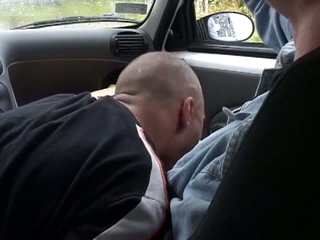 Concupiscent dude gets a blowjob in the car