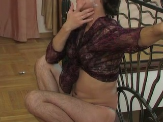 Lewd sissy in a watch-throughout blouse swallowing a hard penis and arse riding