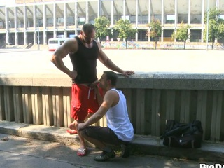 Hot bodybuilder allows his friend to make oral stimulation on the street